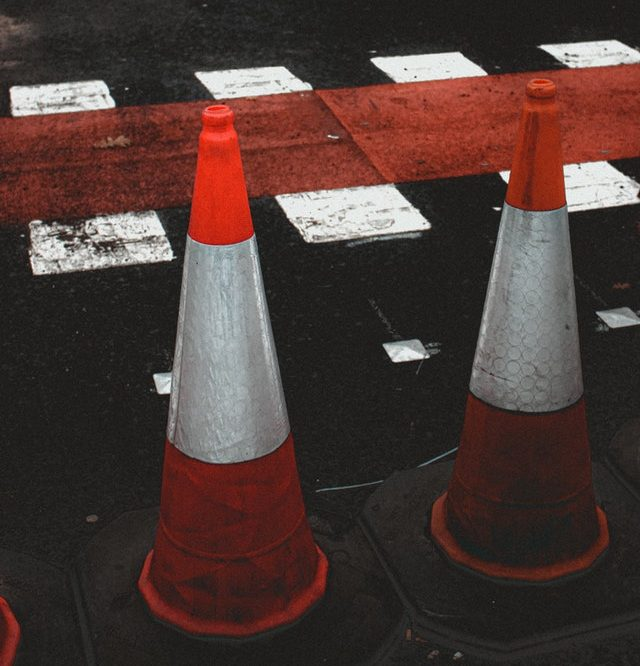 Traffic Cones beside a crosswalk